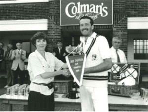 1990  Dereham Captain Mark Ellis receives the Carter Cup from Charlotte Carter